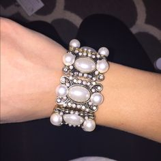Gorgeous gold & pearl bracelet! Great condition, never before worn, gold in color with fake pearl and diamonds, from Charming Charlie's!! Stretchy, made with elastic a Charming Charlie Jewelry Bracelets