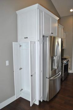 Extra cabinet storage next to refrigerator in a kitchen. | C&M Home Builders and Real Estate, Eau Claire, WI