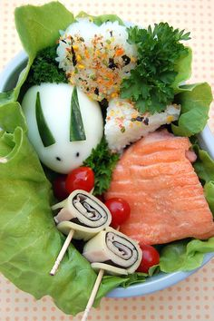 precooked salmon, eggbunny, rice, small tomatoes. SO cute!!