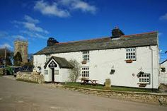 The Old Inn, St Breward - 11th Century inn on the moors, which originally accommodated the monks who built the church. Home cooked food and a warm welcome for dogs and owners alike.