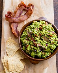 Bacon Guacamole Recipe   Some say everything - even guac - can be better with bacon ... #gatewaymeat #cropsharelove #superbowl   on Food & Wine