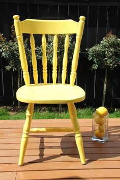 Second hand old wooden chair - sanded down and painted a 'lemon' coloured yellow.