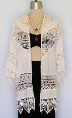 Kimono inspired lace jacket. www.shopmudra.com/