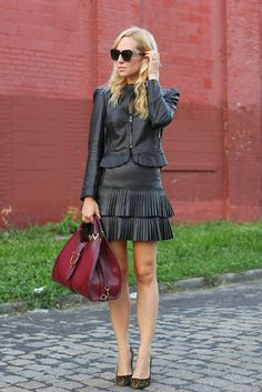 Leather Skirt: BCBG, Shoes: Sergio Rossi, Leather Jacket: Juicy Couture, Handbag:Gucci, Sunglasses: Karen Walker.