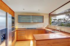 Kitchen of 4219 28th Place and also updated recently. The 2,160-square-foot brick mid-century modern home, built in 1959, three bedrooms, 1.75 bathrooms by Seattle-based Kerf Design and a back patio on a 4,156-square-foot lot. It's listed for $599,000. Photo: Heidi Ward/Coldwell Banker Bain