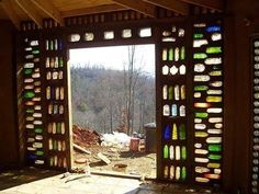 Earthbag Building: Round House Bottle wall gotta have one Cob Building, Building A Chicken Coop, Building A House, Maison Earthship, Earthship Home, Adobe Haus, Earth Bag Homes, Bottle House, Wine Bottle Wall