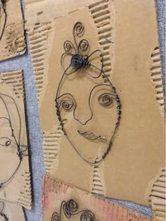 Wire Portraits- love the cardboard mat