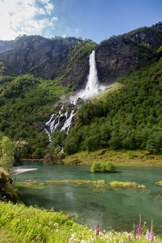Lovely waterfall near the centre of Flåm, Norway  |  Photo by M. Molde  http://www.flickr.com/photos/mmolde/8338568311/