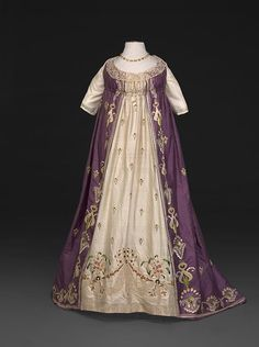 "Elaborately and professionally embroidered taffeta dress, 1798-1802, French. Constructed in one piece as a ""round gown"" but with center panel in white, imitates traditional ""open robe and petticoat."" Such an elaborately embellished dress would have been virtually unknown in the US, despite fashionable Americans' ability to keep up with European fashions and access fine fabrics. Reproduction undersleeves; reproduction necklace from Dames a la Mode. Loan to DAR Museum agreeabletyrant.dar.org"