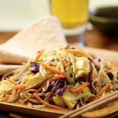 """Moo Shu Vegetables. This vegetarian version of the classic Chinese stir-fry, Moo Shu, uses already-shredded vegetables to cut down on the prep time. Serve with warm whole-wheat tortillas, Asian hot sauce and extra hoisin if desired. INGREDIENTS 3 teaspoons toasted sesame oil, divided 4 large eggs, lightly beaten 2 teaspoons minced fresh ginger 2 cloves garlic, minced 1 12-ounce bag shredded mixed vegetables, such as """"rainbow salad"""" or """"broccoli slaw"""" 2 cups mung bean sprouts 1 bunch…"""