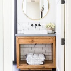 This beauty of a bathroom just hit the pages of the @orangecountyregister!! We're talking all about how to combine trendy and timeless design into the ever popular modern farmhouse style! What one element would you add to your farmhouse dream? #lindyegallowayinteriors  @marisavitalephoto