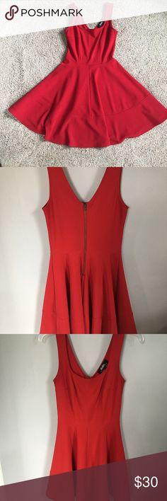 Red Lulu's Dress Skater/fit and flare style Lulu's dress in a vibrant red.  This is perfect for date night or could be paired with a sweater or blazer for work.   I work from home most of the time and am trying to pair down my closet. Lulu's Dresses Midi