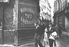 A young man in the Jewish quarter of Paris wears the mandatory Jewish badge. Paris, France, after June 1942.