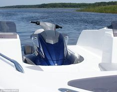 Wave Boat 444 converts a jet-ski into a five-seater boat Wave Boat, Sun Roof, Jet Ski, Mail Online, Daily Mail, Skiing, Boats, Fighter Jets, Waves
