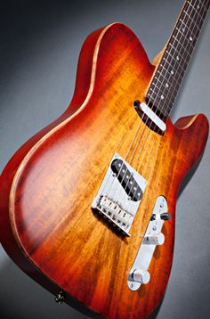 Fender Telecaster. Loving the natural finish...I don't even play, but I love the crunchy tone of a telly.