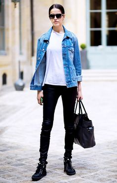 A white t-shirt is paired with a denim jacket, skinny pants, sneakers, rectangular sunglasses, and a leather tote bag