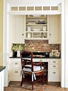 Built-in desk made from matching kitchen cabinetry to unify dining room to kitchen.