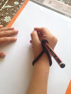 """Pencil Grip Help: """"Wrap a hair tie as shown. Kids get used to doing it themselves quickly. It gently forces them to hold the pencil in the open web of their hands and the pencil with their fingertips. Do this for a few weeks, then remove the ties. By then it's become habit to hold a pencil correctly. Kids that have weak fine motor muscles in their hands are going to struggle, so do strengthening activities. That helps with control and neatness when writing."""" From a friend's FB"""