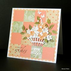 card from Beccy's Place ... 4X4 grid of inchies form a patchwork quilt background ... delightful die cut basket with small flowers ... like the dabs of liquid pearls in flower centers ... sweet look in peaches and pale greens ...