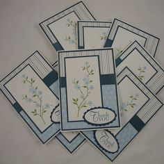 handmade notecard set ... blue patterned papers ... cherry blossom branch with blue flowers ... good sketch ... like them!