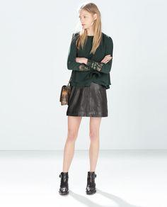 Zara Top With Embroidered Cuff in dark bottle green.