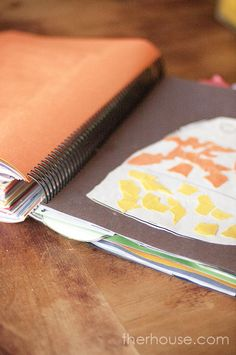 End of the Year Book with School Papers -- take the stack of papers to FedEx/Kinkos and have them spiral bind it into a book!