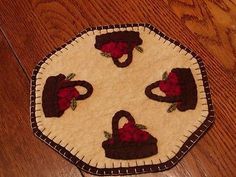 Primitive Candle Mat -Woolfelt Penny Rug-Apple Basket Offered to you by:Bits of Cloth This is a new primitive candle mat. I have handcrafted this from woolfelt and hand-sewn all the pieces with great