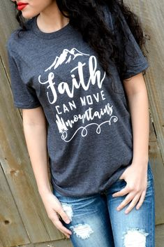 "Our Faith Can Move Mountains Tee is a LaRue Exclusive and features a super soft heather charcoal gray tee with the phrase ""Faith Can Move Mountains"" in white. Made of 50% Cotton and 50% Polyester. Mod"