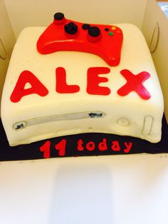 White Xbox cake with red controller