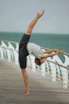 Gorgeous. She must be a gymnast... look at her flexibility, and curled toe point.
