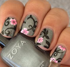 Zoya silver glitter finish with detailed nail art with black broccade style stem & leaf work with pale pink floral blooms. Very detailed work, a true Artist.