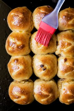 Our vegan hot cross buns combine sultanas, applesauce, cinnamon and orange zest for indulgent, fluffy buns that you won't believe are vegan.