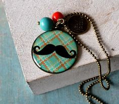 Mr Moustache  medaillon necklace in brass coral by fleurfatale, €25,00