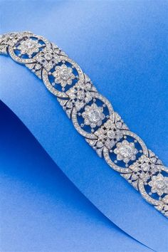 A Fine Platinum and Diamond Bracelet, Circa 1918, in an intricate openwork link design with millegrain edgework, containing two old European cut diamonds weighing 1.12 and 1.03 carats, six old mine and European cut diamonds weighing 3.42 carats total, and 437 old mine, old European, antique single and rose cut diamonds weighing 12.25 carats total. Edwardian Jewelry, Antique Jewelry, Silver Jewelry, Vintage Jewelry, Silver Ring, Silver Earrings, Antique Bracelets, Moonstone Jewelry, Vintage Silver