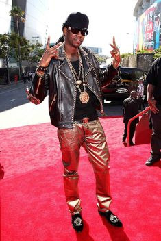 OD'ing.  Chainz was looking like a Jamaican refugee from the Emerald City in the Wiz with his gold lame pants and accessories.