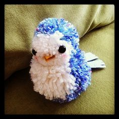 blue and white pom pom bird handmade with yarn by katy kristin