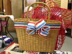 Cute way to embellish a basket - love that ribbon!