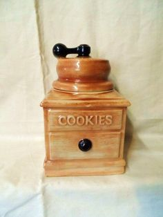 Check out this item in my Etsy shop https://www.etsy.com/listing/184661731/mccoy-usa-coffee-ginder-cookie-jar-rare