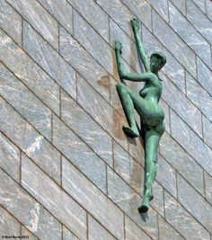 """The sculpture titled """"Aspiration"""" can be found crawling up the exterior wall of the Treasury Building, in south central Dublin. The statue represents the struggle for freedom in Ireland, which eventually led to the Easter Rising in 1916."""