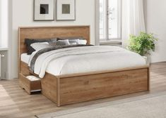 Add a splash of country style elegance and rustic simplicity to your home with the stunning Stockwell Rustic Oak Wooden Bed. The Stockwell Rustic Oak Wooden Bed truly is the perfect combination of classical charm and modern style, easily able to mainta Wooden Bed With Storage, Bed Frame With Drawers, Bed Frame With Storage, Bed Storage, Double Bed With Storage, Small Double Beds, Beds With Storage Drawers, Bed Frame With Headboard, Boho Bed Frame