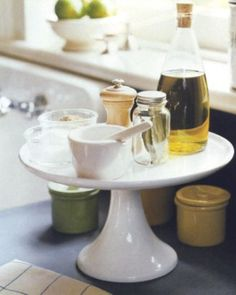 ~Clear up the clutter and make the most of your countertops by using a cake stand to hold olive oil, salt, pepper, and other frequently used seasonings. The stand makes it easy to find and use these ingredients while you cook, and gives you space to arrange other herbs and spices around the base of the pedestal.