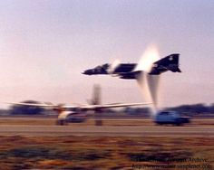 F-4J Phantom II from VX-1 breaking sound barrier at low altitude.