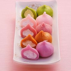 Cream Dango = dumplings with cream filling. Flavors: matcha (green tea), white peach, raspberry, coffee, purple sweet potato