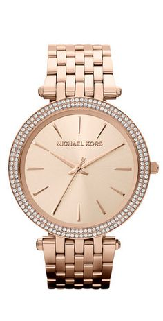 "An elegant addition to your collection: a glistening Darci watch from Michael Kors. | Gold-tone stainless steel bracelet (6-9/10"" L) 