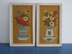 Want the perfect accent for your vintage style room? This is the perfect set of folk art from the 1960's. They are of two water pitchers filled with flowers. The frames are white washed/distressed. They are in great condition with just one piece of yarn that was pulled at a tiny bit. They are 14 1/2 inches tall, 8 1/4 inches long, and 1/2 inch wide.