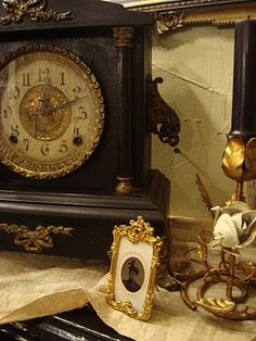 I Love antique clocks, ornate miniature picture frames, and the lovely metal roses!  Very nice !