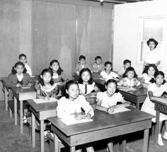 Japanese language school, Valley Japanese Community Center, early 1950s. The building, tables, and stools were built by the school children's fathers. The Japanese alphabet is visible to the right of the image. Valley Japanese Community Center. San Fernando Valley History Digital Library.