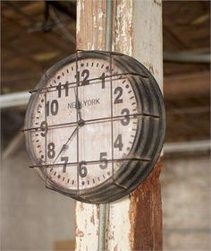 Reminiscent of 1940's schoolhouse clocks, our Vintage Industrial Gymnasium Clock has an eye-catching style. Made of metal with protective wire grill cover and a distressed finish, this clock might even inspire you to shoot some hoops.