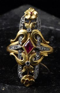 Art Nouveau Ring | Fabian Montjoye. France. Marquise ring set with a ruby. Yellow gold, lozenge shape.