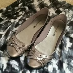 American Eagle ballet flats Silvery/bronze color with metal stud detail So, so cute! One small scuff that I had to hold just right in the light to see. American Eagle by Payless Shoes Flats & Loafers
